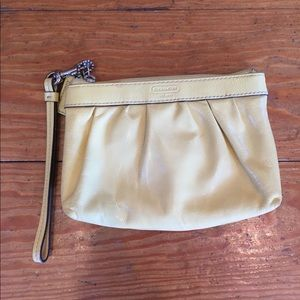 Yellow Coach patent leather wristlet